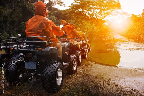 Poster Motorise atv sport vehicle team ready to adventure in mud track