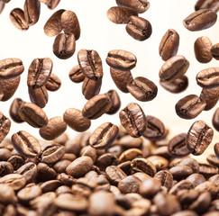 Fototapeta Falling coffee beans isolated on white