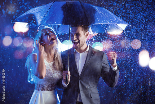 Acrylic Prints Fashion style portrait of a couple posing in the rainy weather