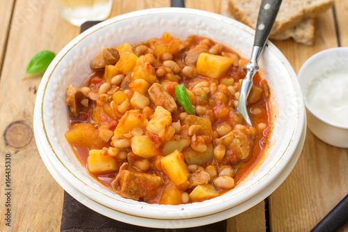 Potato stew with pork and white kidney beans
