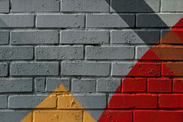 Colorful very small fragment of street graffiti, brick wall. Abstract creativ...