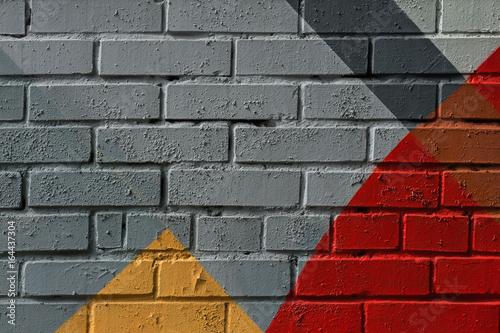 Colorful very small fragment of street graffiti, brick wall. Abstract creativ...