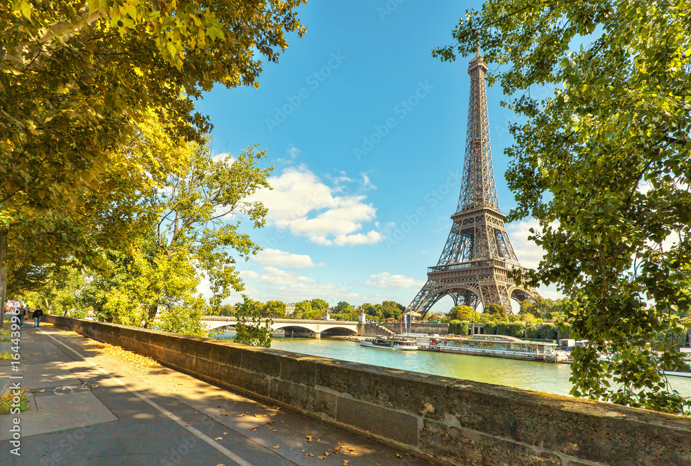 The Eiffel tower in Paris. Jena Bridge is a bridge spanning the River Seine in Paris.