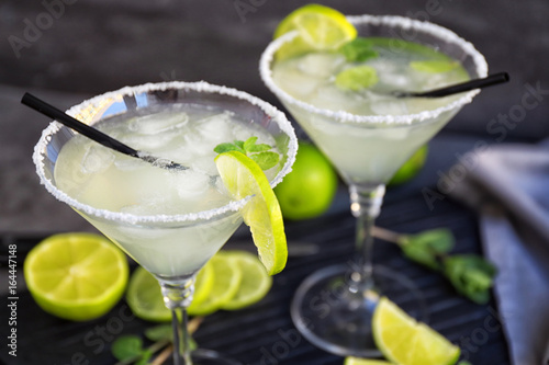 Delicious margarita cocktail on wooden board