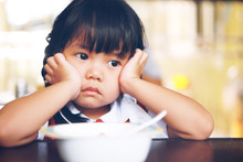 Asian Children Cute Or Kid Girl Student Anorexia Or Sad With Vacant And Prop Up Or Hand To Cheek On Food Table For Breakfast Before Going To School For Study On Vintage Style