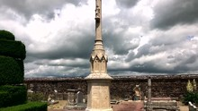Cross And Tombstones At An Old...