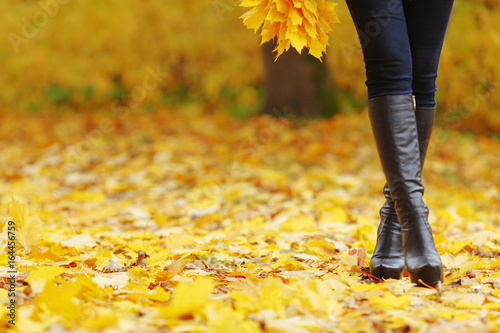Fototapeta Woman walking in autumn park obraz