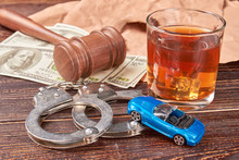 Gavel And Money Beside Alcohol...