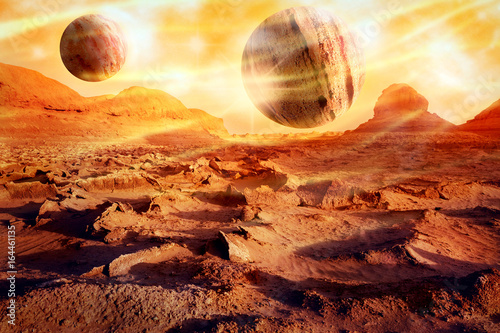 Planets over a lifeless desert. Space landscape in red-yellow tones. Alien planet concept. Artistic image.