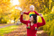 Mother and baby in autumn. Fall outdoor family fun.
