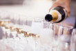 canvas print picture - Bartender pouring champagne into glasses