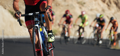 Foto op Plexiglas Fietsen Cycling competition,cyclist athletes riding a race,climbing up a hill on a bicycle