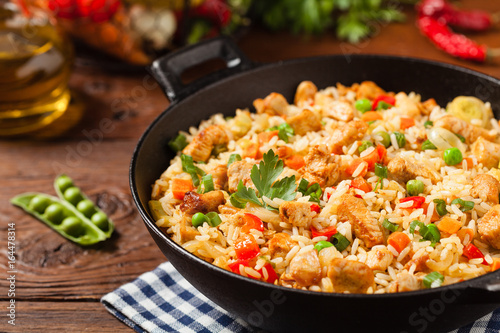 Fotografie, Obraz  Fried rice with chicken. Prepared and served in a wok.