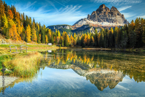 Beautiful alpine lake with high peaks in background, Dolomites, Italy