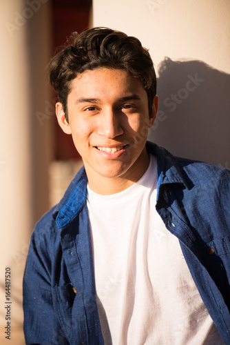Fotografie, Obraz  Handsome hispanic young adult, smiling and looking at camera