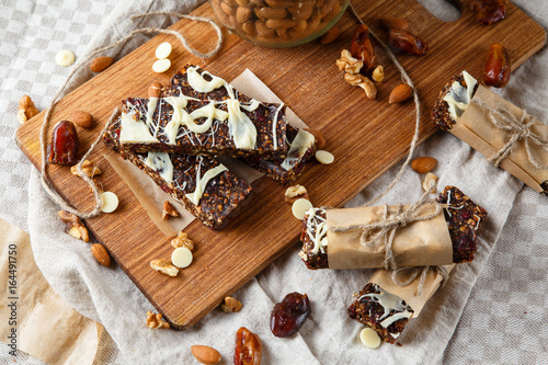 Organic homemade granola bars on wooden background - Healthy vegetarian vegan diet snack granola bars with