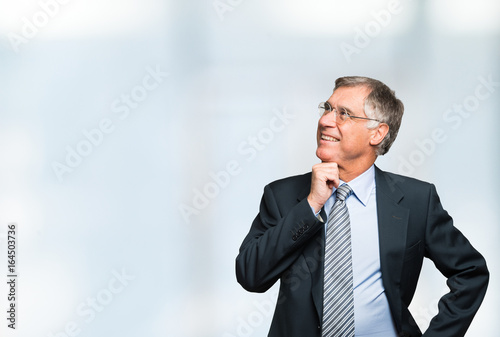 Valokuva  Businessman looking a bright background