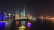 Shanghai skyline at night. On the left, Pudong with the Oriental Pearl Tower. On the right, The Bund (Puxi Waitan).