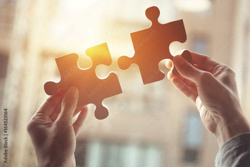 Fototapety, obrazy: Businesswoman hand connecting jigsaw puzzle with sunlight effect, Business solutions, success and strategy concept.