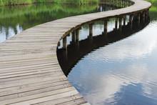 Wooden Bridge Over River In Gr...