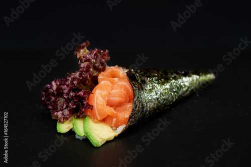 Sushi on black background Wallpaper Mural