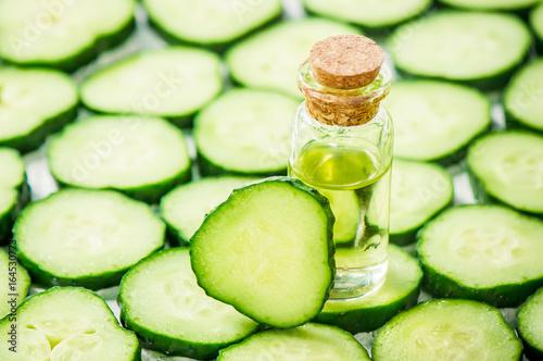 Fotografie, Obraz  The cucumber extract. Cosmetics. Selective focus.