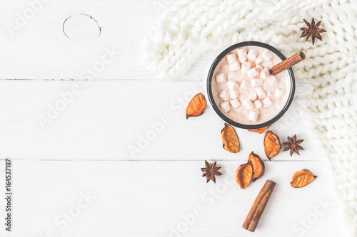Autumn composition. Hot chocolate, knitted blanket, autumn leaves. Flat lay, top view, close up