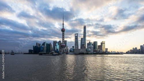 Photo Stands Shanghai Shanghai skyline,landmarks of Shanghai with Huangpu river at sunrise/sunset in China.