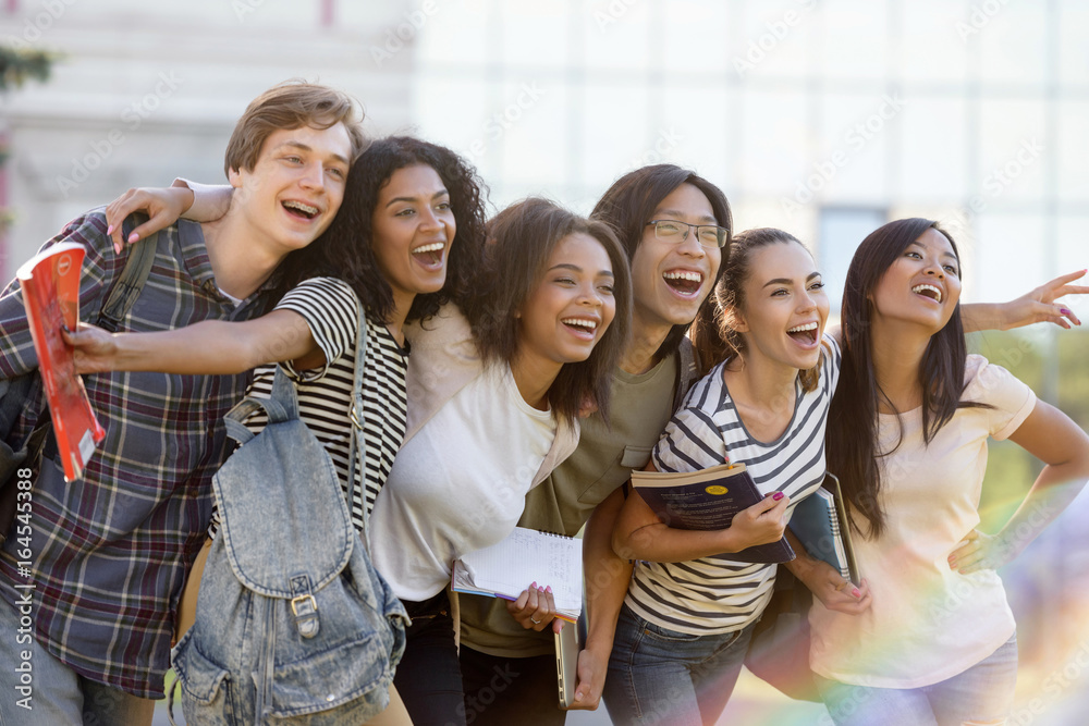 Fototapety, obrazy: Multiethnic group of young happy students standing outdoors