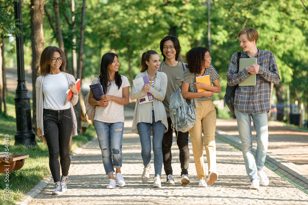 Fototapety, obrazy: Happy young students walking outdoors
