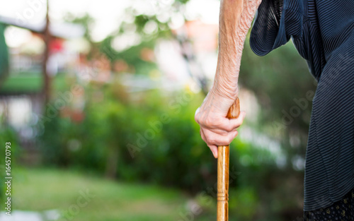 Fotografie, Obraz  Senior woman walking with a cane