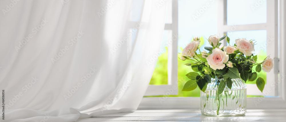 Fototapeta Bouquet of rose flowers near window