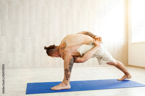 Man Practicing Advanced Yoga A Series Of Yoga Poses Lifestyle Concept Buy This Stock Photo And Explore Similar Images At Adobe Stock Adobe Stock