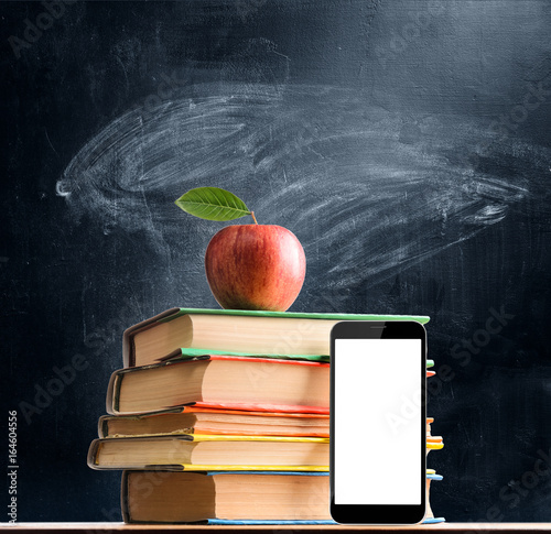 School Books Smartphone And Fresh Apple Against Chalkboard Background