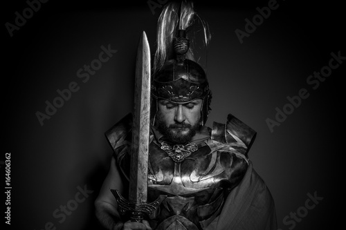 Fotografie, Obraz Army, Roman centurion with armor and helmet with white chalk, steel sword and lo