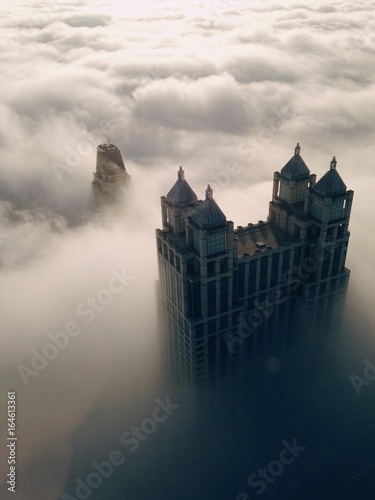 Obrazy na płótnie Canvas Elevated View Of Skyscrapers In Clouds