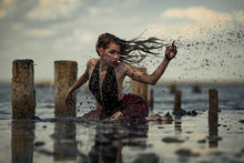 Young Woman Bathing In Therapeutic Water Of Mud Estuary.