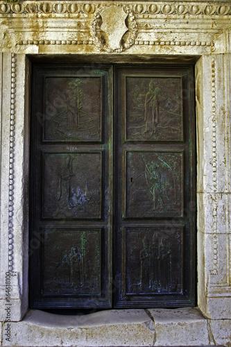 Fotografie, Obraz  Bronze paneled door of St. Stephen Cathedral in  Hvar, Croatia