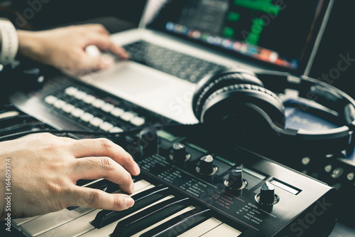 Photo Music producer is recording sound on Computer