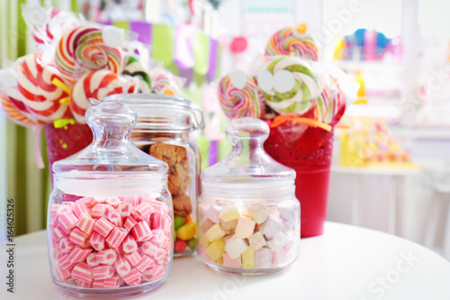 Keuken foto achterwand Snoepjes Different sweets in jars at candy shop
