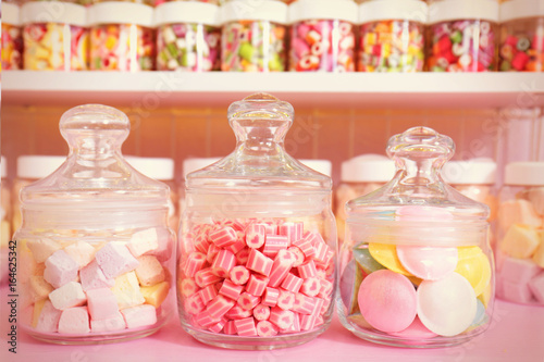 Poster Confiserie Different sweets in jars at candy shop