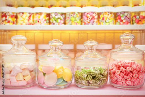 Garden Poster Candy Different sweets in jars at candy shop