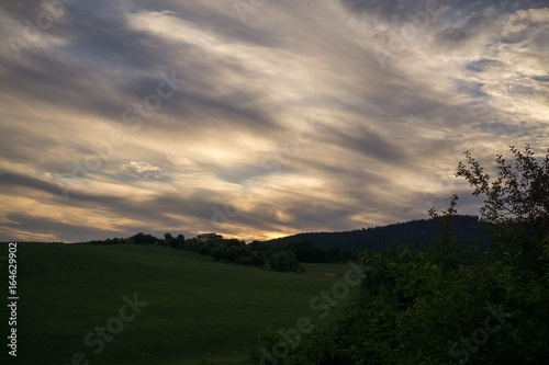 Cadres-photo bureau Colline Colorful sunset on meadow. Slovakia