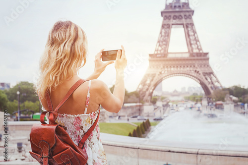 tourist in Paris visiting landmark Eiffel tower, sightseeing in France, woman ta Canvas