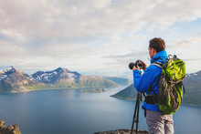 Professional Landscape And Nature Photographer With Tripod Outdoors, Travel To Norway