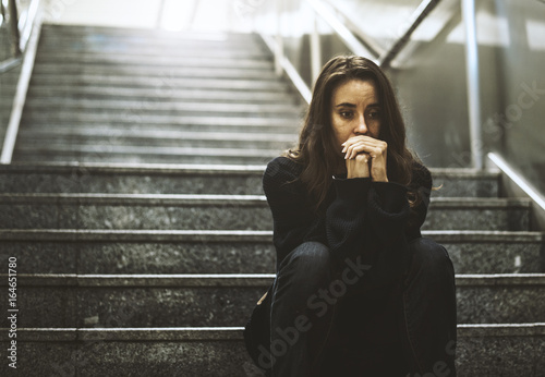 fototapeta na drzwi i meble Adult Woman Sitting Look Worried on The Stairway
