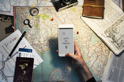 Closeup of hand with mobile phone over map background Fototapeta