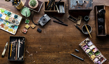 Aerial View Of Artistic Euqipments Painting Tools On Wooden Table