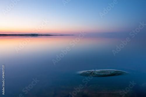 Fotografie, Obraz  Tranquil minimalist landscape with rock in calm water