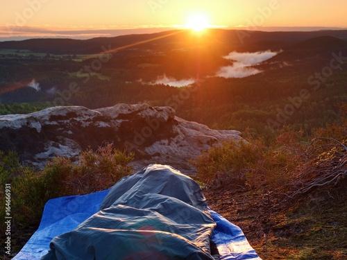 Beautiful awakening in a sleeping bag on  rock ledge Canvas Print